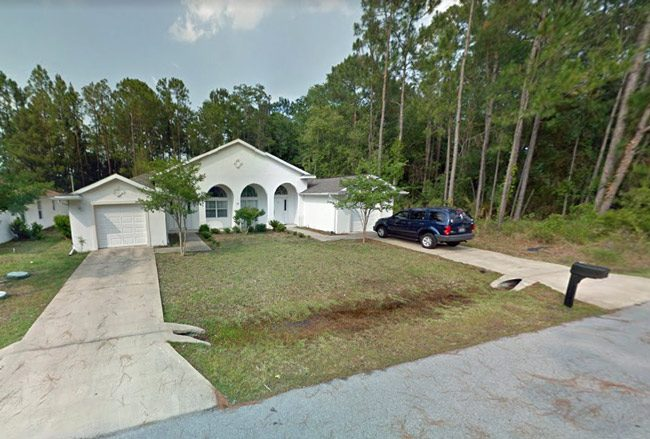 The duplex at 12A Bunker Knolls in Palm Coast, and Tyrone Hartley's GMC in the driveway.