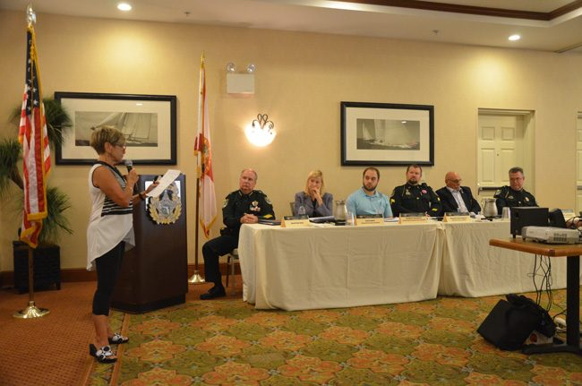 Lynne B. Rosewater, left, addresses the wrap-up meeting of a domestic violence task force at a meeting at the Hilton Garden Inn in Palm Coast Friday afternoon. Sheriff Rick Staly, second from left, convened the task force in June. Members of the task force included, from left, Carrie Baird, Jonathan Tanenbaum, Chris Ragazzo, Ed Reistetter and Jack Bisland, the undersheriff. (c FlaglerLive)
