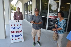 Early voters marked the occasion with a picture, (© FlaglerLive)