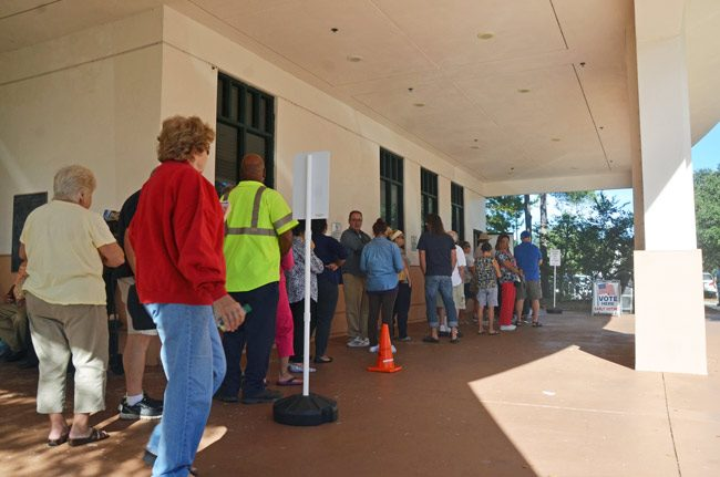 Early voting in Flagler, as at the public library location above, has been brisk through seven days, but if it will break records, it will not shatter them: the pace is only slightly ahead of that of 2008. (© FlaglerLive)