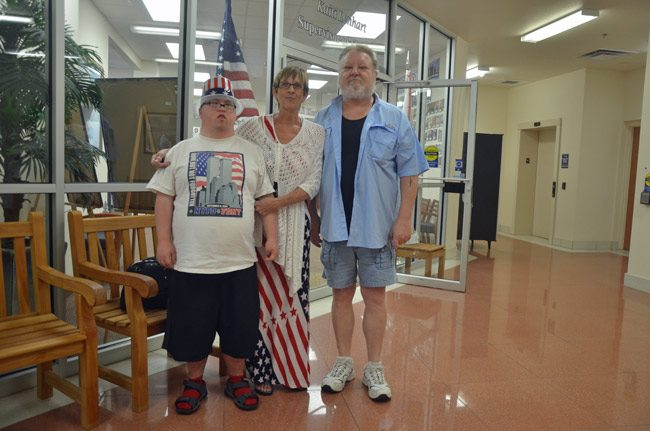In an election season with few heroes, one stands out: the voter. Here was a family of voters who'd just cast their ballots early on Thursday, at the Supervisor of Elections office in Bunnell, with clothes to fit the occasion. From left, Alec, Gloria and Leonard Best, of Palm Coast. (© FlaglerLive)