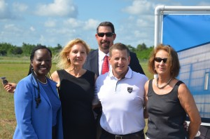 The team that landed Aveo: from left, Deputy County Attorney Sally Sherman, Economic Development Director Helga van Eckert, County Administrator Craig Coffey, Aveo's Christian Nielsen, and County Commission and Jobs Council Chairwoman Barbara Revels. Click on the image for larger view. (© FlaglerLive)