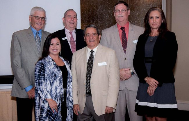 The Flagler Education Foundation is the school district's non-profit arm, fund-raiser and support organization, underwriting many scholarships and programs. The foundation installed its new officers at a banquet at Hammock Beach Resort Monday evening. From left, Dave Taylor, Treasurer, David Alfin, Secretary, Mike Beadle, President,  County Judge Melissa Moore-Stens, who  installed the Board but isn't a member,  Catherine Evans, Vice-President, and Joe Marotti; President-Elect. Joe Rizzo, the organization's executive director, is not in the picture, but was at the banquet. (Jason Wheeler)