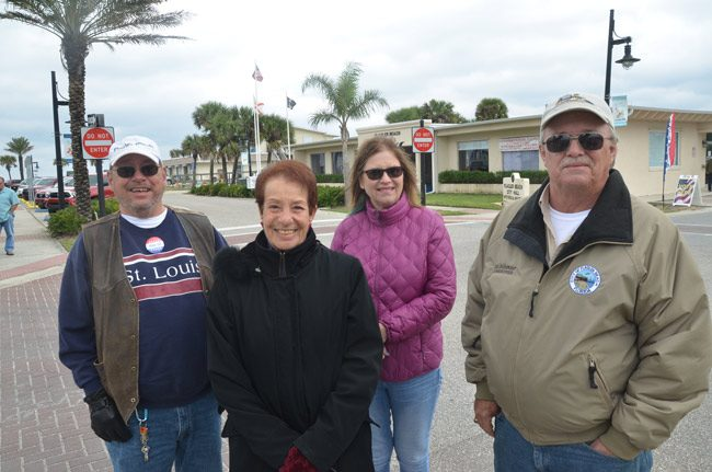 The contestants in Flagler Beach around midday today: from left. Paul Eik, incumbent Jane Mealy, Deborah Phillips, and incumbent Rick Belhumeur. (© FlaglerLive)