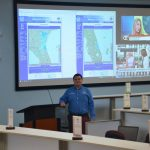 Flagler County Emergency Management Chief Jonathan Lord. When fully activated, the Emergency Operations Center, where Lord is standing, previously drew 60 to 70 people. That won;t be the case in Covid-affected emergencies, when the EOC will top off at 20 to 30 people, with others working remote. (© FlaglerLive)