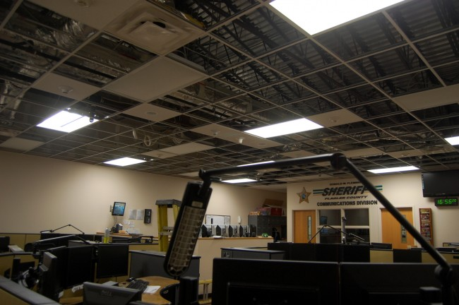 Most of the 911 call center's ceiling tiles were blown out by the downward draft of the fire suppression system. Click on the image for larger view. (© FlaglerLive)