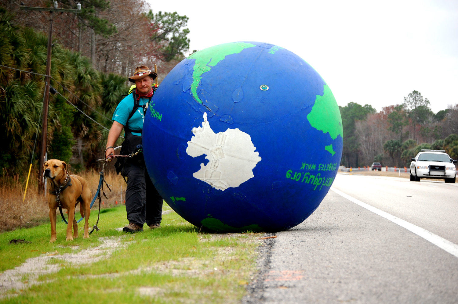 Erik Bendl, the World Guy, and his dog Nice, doing Bunnell. Click on the image for larger view. (© FlaglerLive)