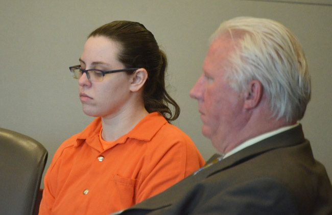 Erin Vickers in court this morning with her attorney, Garry Wood. She goes on tgrial on Sept. 18. (© FlaglerLive)