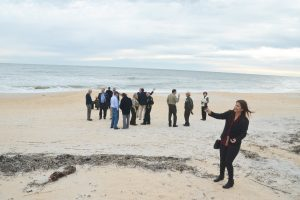 Just before Gov. Scott arrived, County Engineer Faith al-Khatib took a panoramic video of the scene, including the makeshift dunes rebuilt after they were breached and demolished at Washington Oaks Gardens State Park. Click on the image for larger view. (© FlaglerLive)