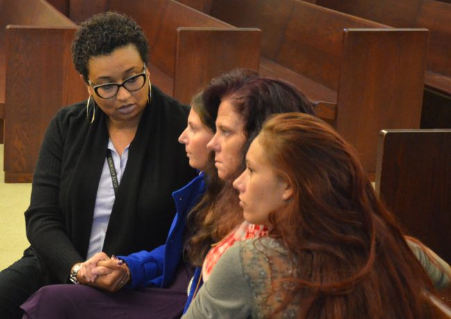 Tiffany Norman, second from left, with the victim's advocate, her mother and her sister shortly after the verdict. (© FlaglerLive)