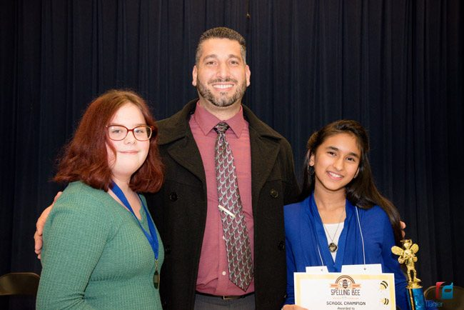 Buddy Taylor Middle School Principal John Fanelli has reason to be proud, as the winner of the 2018 county spelling be, 8th grader Keelin Cowart-Goldberg, left, and the runnerup, 7th grader Alisha Jageswar, are both his students. (Flagler Schools)