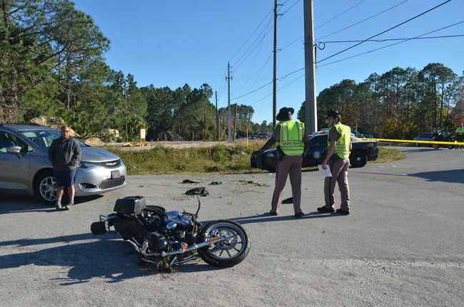 The motorcyclist swerved off U.S. 1, struck a road sign and a culvert, went airborne and crashed by the van, the motorcycle coming to rest a few feet further on. (c FlaglerLive)