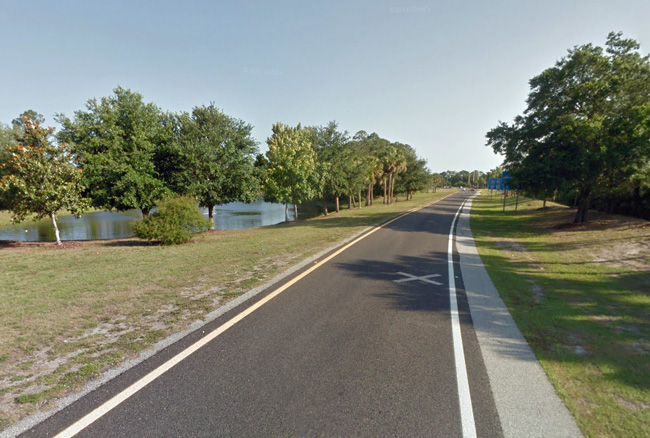 The exit ramp off of I-95's northbound lanes onto Palm Coast Parkway. Ken Yarborough did not negotiate the curve and drove his car into the pond to the left.