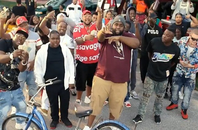 A still from a music video shot in Bunnell by the rapper known as FatAss, center in the foreground. The production triggered an effort by Bunnell government to regulate video and other movie productions in the city.
