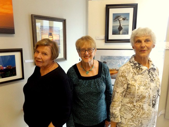 Flagler County Art League members Joan Mangano , right, current president Ann DeLucia (middle) and Joan Howard at the Flagler County Art League's gallery and studio in City Market Place in Palm Coast. The art league celebrates its 40th anniversary this year. (© FlaglerLive)