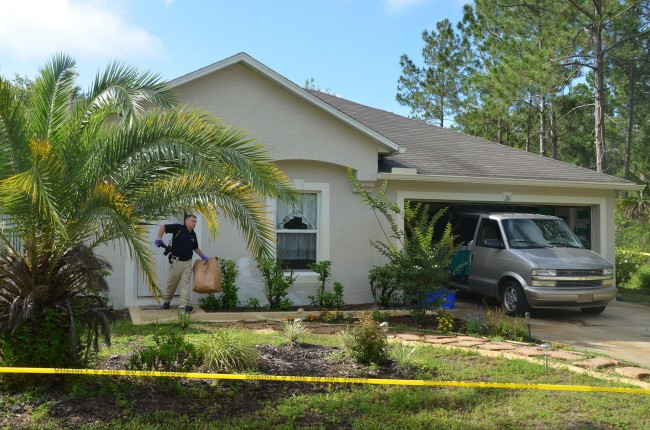An FDLE crime lab leaving Leonard Lynn's home this morning. Click on the image for larger view. (© FlaglerLive)