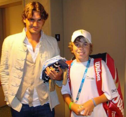 Opelka and Roger Federer eight years ago in an image Opelka's father George Tweeted today. Opelka has grown a bit since.