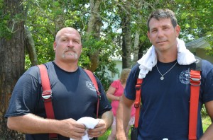 Firefighter Michael Chandley, left, who's been with the Palm Coast Fire Department 10 years, and Lt. Jason Wagner, with the department almost 18 years, saved the dog. Click on the image for larger view. Click on the image for larger view. (© FlaglerLive)