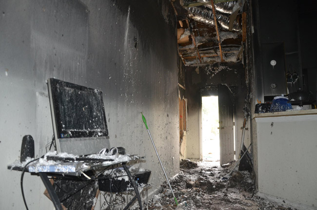 Melissa Bodiford says her son left his new hoverboard at the entrance and started watching television when the device exploded and triggered a fire that ravaged the interiors of the house Thursday in Palm Coast's B Section. (© FlaglerLive)