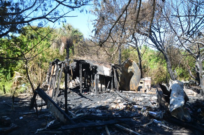 Little was left of a double-trailer flames consumed early Saturday morning in Flagler Beach, killing the sole resident inside. Click on the image for larger view. (© FlaglerLive)