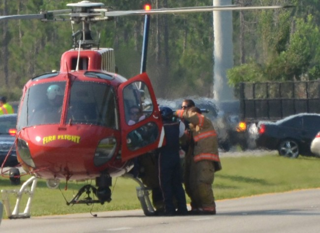 Flagler County Fire Flight in action last Thursday, picking up a trauma patient after a motorcycle wreck on U.S. 1. Click on the image for larger view. (© FlaglerLive)