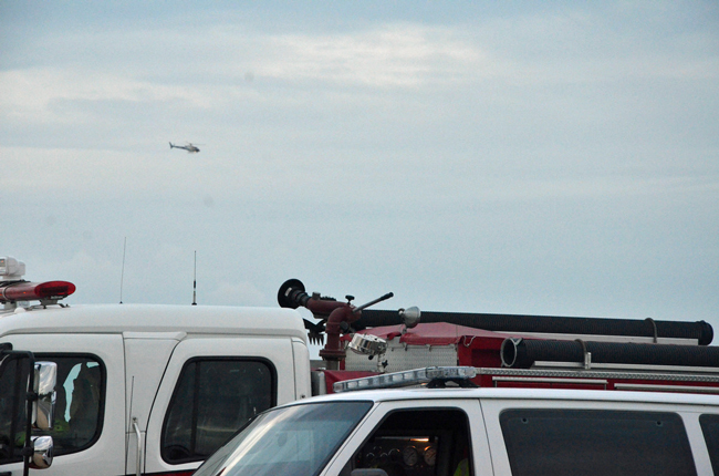 Flagler County's Fire Flight, the emergency helicopter--seen here in a file photo--, flew above the surf off Flagler Beach Sunday in a search for a possible drowning victim. (c FlaglerLive)