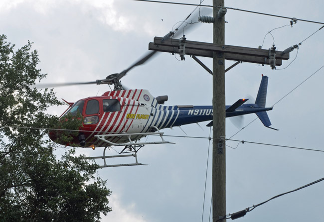 Fire Flight, Flagler County Fire Rescue's helicopter, flew Kathy MacDonald to Halifax Hospiotal Friday evening after her husband drover her to the intersection of County Road 302 and County Road 305. This is a file photo of Fire Flight. near the Mondex last April. (© FlaglerLive)