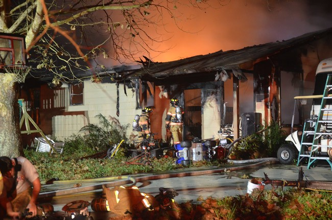 The house was fully engulfed in flames when firefighters arrived, and by 10 p.m. was  under control, but still burning in parts. (© FlaglerLive)