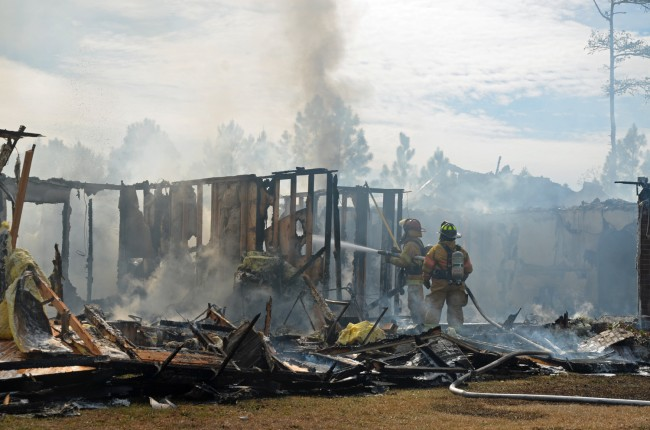 Firefighters battled what remained of Ron Walker's house in Rima Ridge. Click on the image for larger view. (c FlaglerLive)