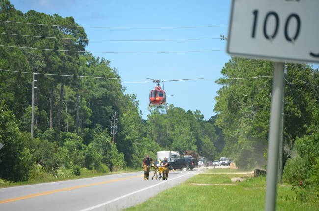 Flagler County Fire Flight takes off from its improvised landing zone on State Road 100, with Jerry Culver aboard. Click on the image for larger view. (© FlaglerLive)