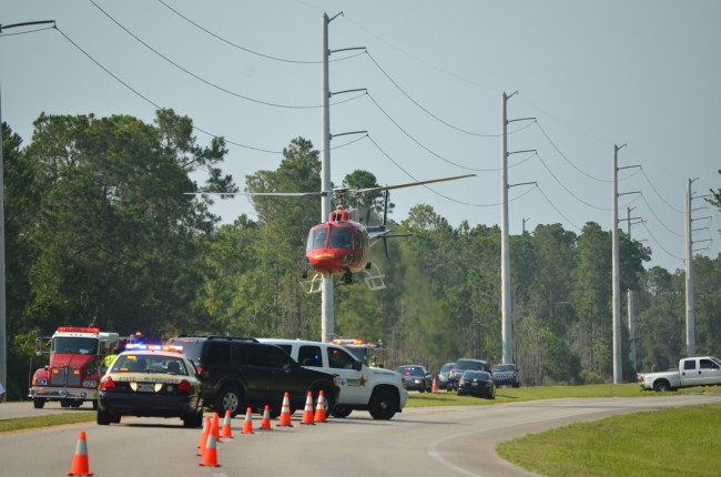 Flagler County Fireflight, the emergency helicopter, takes off from the northbound lanes of U.S. 1 at 5:30 this afternoon, with the victim of the motorcycle wreck onboard. Click on the image for larger view. (c FlaglerLive)