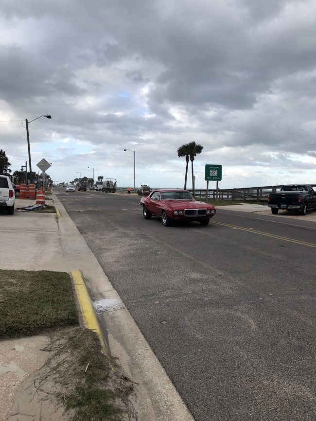 The first car to make it across the newly opened road, southbound. (Rick Belhumeur)