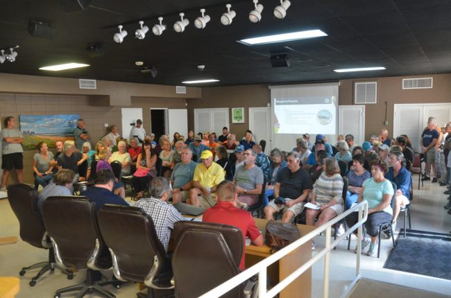 Some 100 people filled City Hall's commission chamber this afternoon for an informational meeting on the swale-digging project at the south end of town. (© FlaglerLive)