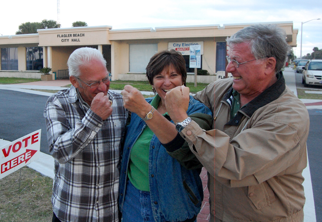 From left, Marshall Shupe, Kim Carney and Phil Busch, Flagler Beach's three candidates for two city commission seats, less than two hours before polls closed Tuesday afternoon. They were in a witty mood. (© FlaglerLive)
