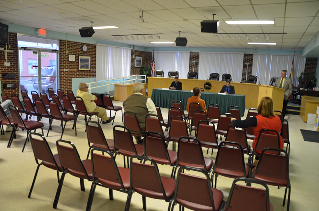 Flagler Beach City Manager Brice Campbell spoke to a mostly empty chamber before Bobby Pace and  Brandon Seymour made their case to be the city's next fire captain Thursday evening. (© FlaglerLive)