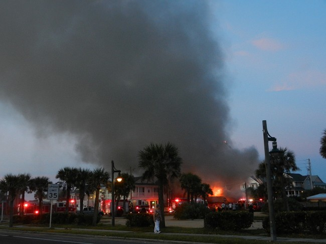 The dawn fire at the Seaside Shoppe was captured by Sherry Baker. (© Sherry Baker for FlaglerLive)