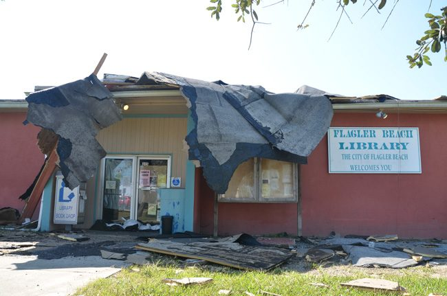 The Flagler Beach Public Library had been closed since Hurricane Matthew last year, for repairs. It was to open later this month. Not anymore. Its roof was torn out by Hurricane Irma. (c FlaglerLive)