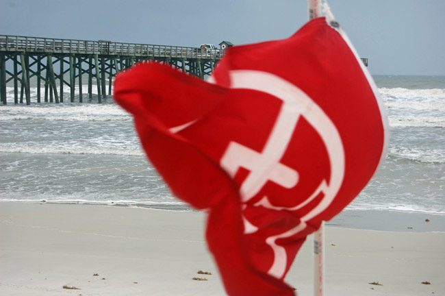There will be a total of 14 lifeguards instead of 30 in Flagler Beach this summer season after the city cut $100,000 out of its budget. (© FlaglerLive)