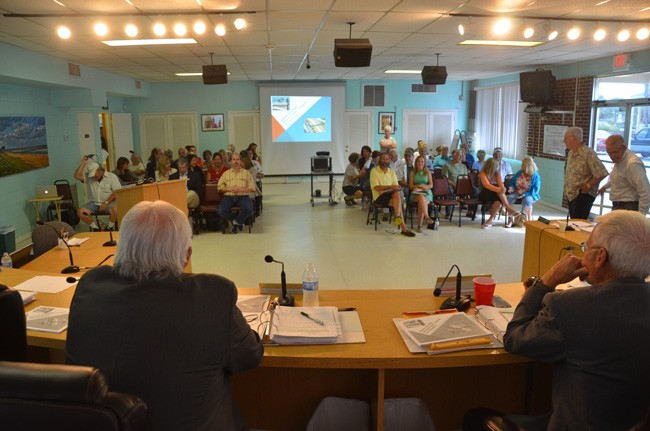 Flagler Beach City Commissioners, seen here moments before the start of this evening's meeting, eventually faced about 60 residents and busines owners, almost all of whom opposed a proposal to impose paid parking in the city. (c FlaglerLive)