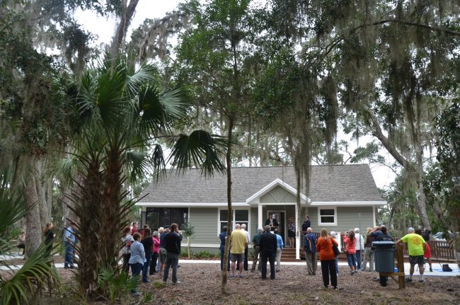 County Administrator Craig Coffey spoke at this morning's dedication of three cottages designed for use by tourists and researchers at Princess Place Preserve. Click on the image for larger view. (© FlaglerLive)