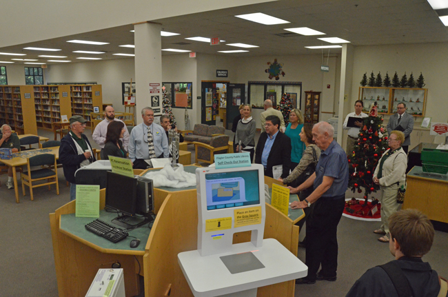 Flagler County Library Director Holly Albanese, toward the left, led county commissioners on a tour of the main branch Tuesday morning in hopes of persuading them to soon approve expansion plans in line with the library's changing mission. (© FlaglerLive)