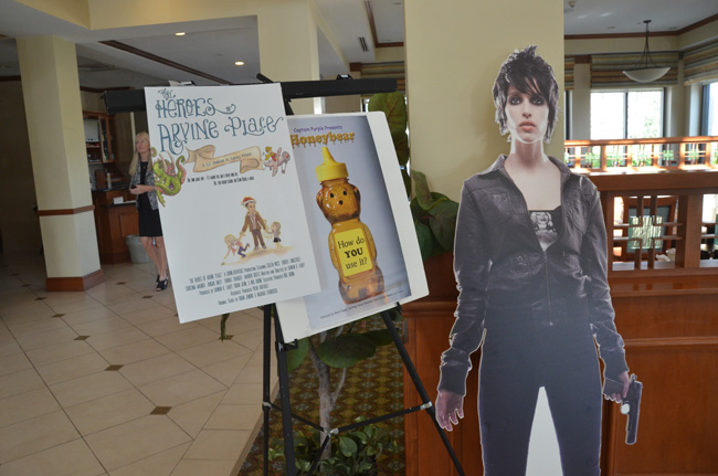A promotional set-up for one of the movies shown at the inaugural Flagler Film Festival in January. The second edition will be held at the same Hilton Gaden Inn. Kathryn Barry, one of the three founders of the festival, is just visible to the left. (© FlaglerLive)