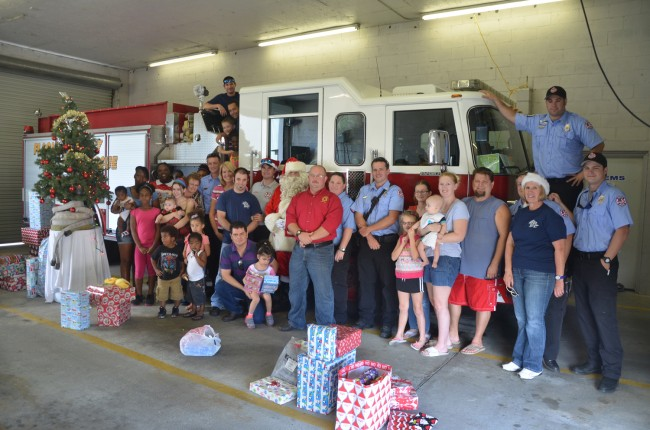 Christmas at Flagler County Fire Rescue's Station 92 today meant that 58 children got most of their wish lists filled, thanks to the donations of firefighters and their families. Click on the image for larger view. (© FlaglerLive)