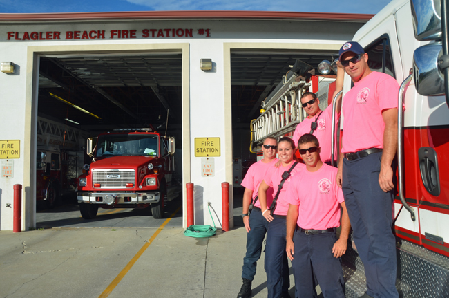 All month the Flagler Beach Fire Department's nine paid and 20 volunteer firefighters will be responding to calls in their pink shirts--which sell for $20 and will be available at First Friday Oct. 4--in the department's effort to raise awareness for breast cancer. From left, Steven Cox, Morgan Walden, Clint Dixon, Bradley Cooper and David Kennedy. (© FlaglerLive)