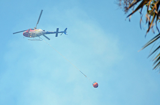 Fklagler County's Fire Flight helicopter was called into action to battle a blaze near the Flagler-Volusia County line Monday afternoon. (© FlaglerLive)