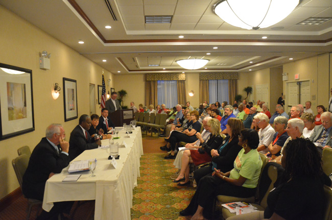 The chamber's political forum at the Hilton Garden Inn Tuesday drew a smaller crowd than its primary edition. Above, the county commission candidates presented. (© FlaglerLive)