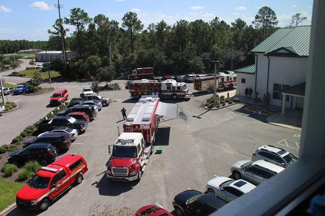 Emergency vehicles in the Government Services Building's parking lot this afternoon. (Flagler County)