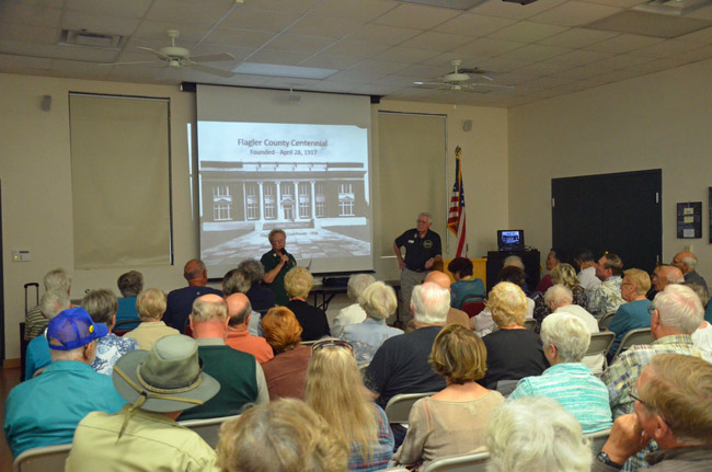 Last week's talk by Sisco Deen, right, focused on Jack Clegg's history of the county, launched the annual Flagler Reads Together events in conjunction with the county's centennial celebrations. Friends of the Library President Terry Jones introduced Deen at the standing-room-only event at the Flagler County Public Library. (© FlaglerLive)