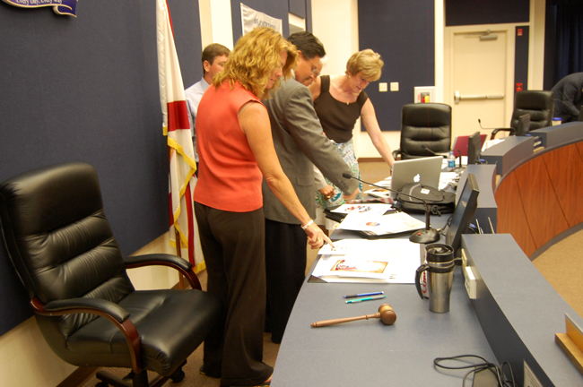 From foreground, Flagler County School Board members Colleen Conklin, Andy Dance and Sue Dickinson, with Trevor Tucker half-hidden. (© FlaglerLive)