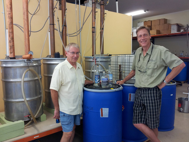 Stan Popowski left, and Jimmy Day in their Hargrove Grade distillery, which now produces 1,000 gallons a month of the the good stuff. (© FlaglerLive)